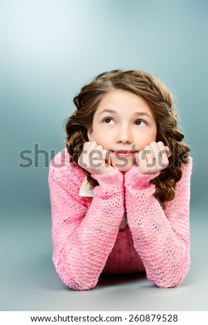 Cute smiling girl with braids. Education. Studio shot. - stock photo