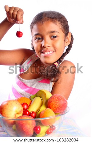 cute smiling girl with various fruits