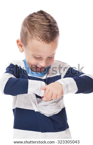 Cute smiling kid checking pocket on isolated white