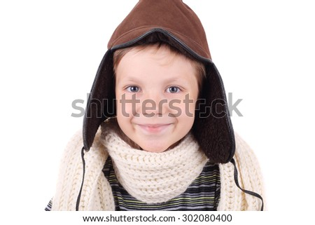 cute smiling little boy wearing winter cap and scarf - stock photo