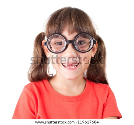 Cute smiling little girl in funny glasses