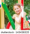cute smiling little girl on the kids playground - stock photo