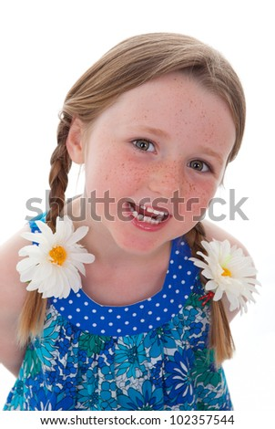 cute smiling little girl with braids or plaits and freckles - stock photo
