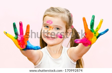 Cute smiling little girl with hands in paint isolated - stock photo