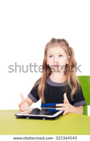 cute smiling little girl with the tablet PC