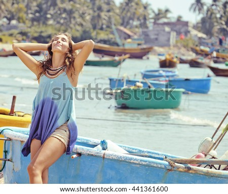 cute smiling young real woman in asian port, vietnam traveller - stock photo