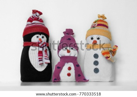 Cute snowman penguin toys made white stock photo 774762145 cute snowman and penguin toys made of white black and colorful socks with hat solutioingenieria Images