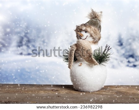 Cute snowman in the snow - stock photo