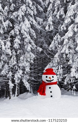 cute snowman on snowy forest - stock photo