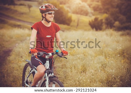cute sportswoman on bicycle. Active Leisure - stock photo