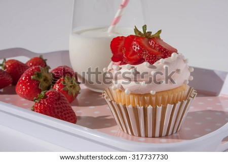 Cute strawberry cupcake and milk