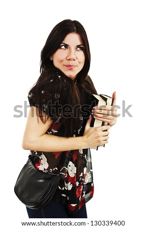 Cute student teenage girl dreaming about something. Isolated on a white background - stock photo