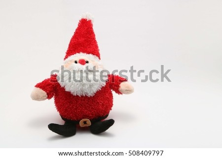 Cute stuffed toy Santa Claus on white background.santa claus doll.