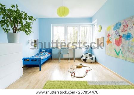 Cute stylish designed interior of small children room - stock photo