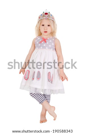 cute sweet little girl standing in the festive dress and the diadem