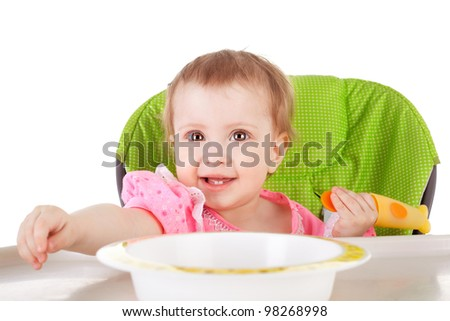 cute sweet smiling little baby having a dinner - stock photo