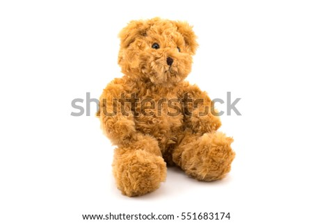 Cute teddy bear sitting on white background