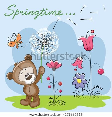 Cute Teddy Bear with dandelion on a meadow  - stock photo