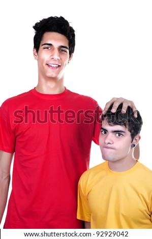 cute teen boys big and small on white background