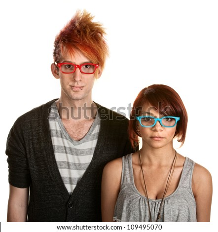 Cute teen couple with red and blue eyeglasses - stock photo