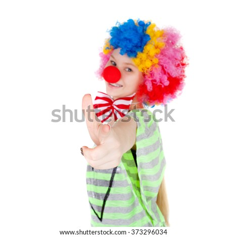 cute teen girl dressed as a clown, focus on the hand