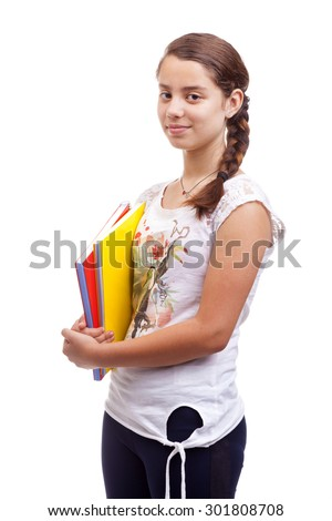 Cute teen girl holding notebooks on white background - stock photo