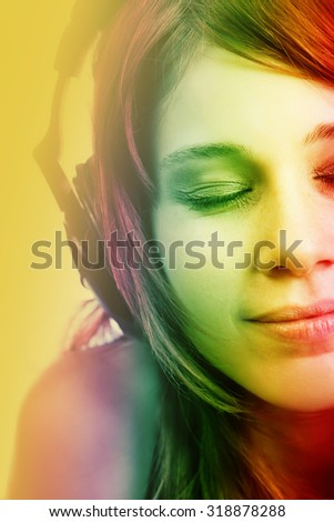 Cute teen girl listening music to headphones - stock photo