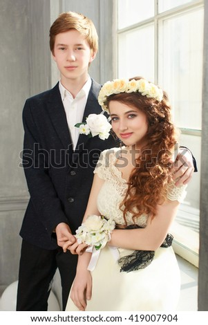 Cute Teenage Prom Couple in beautiful interior - stock photo