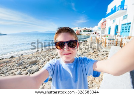 Cute teenage tourist making selfie at Little Venice area on Mykonos island, Greece - stock photo