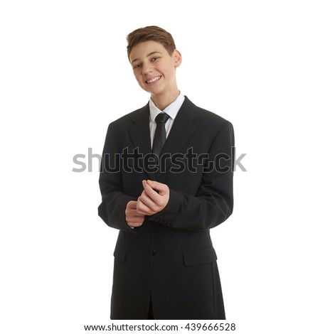 Cute teenager boy in back business suit correcting it over white isolated background, half body, future career concept