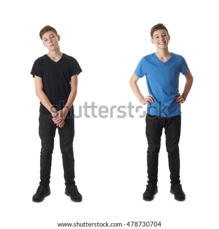 Cute teenager boy in black T-shirt standing over white isolated background full body