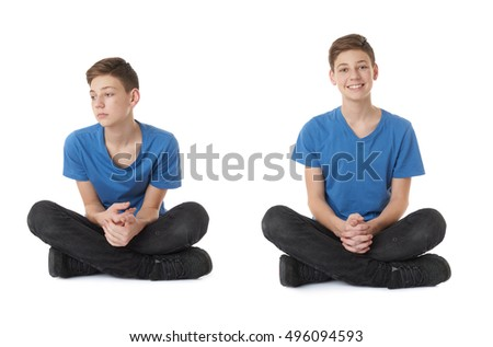 Cute teenager boy in blue T-shirt and lotus posture over white isolated background