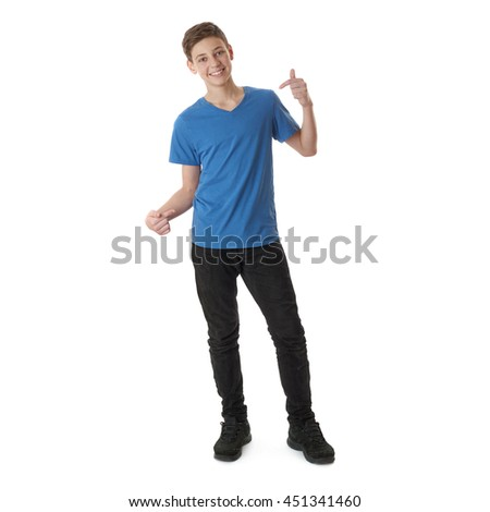 Cute teenager boy in blue T-shirt standing and pointing himself over white isolated background full body - stock photo