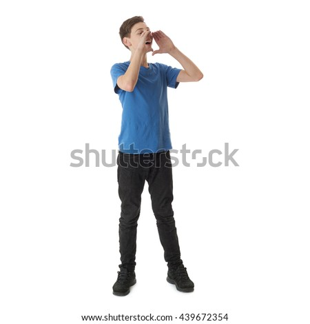 Cute teenager boy in blue T-shirt standing with megaphone sign over white isolated background full body mouthpiece - stock photo