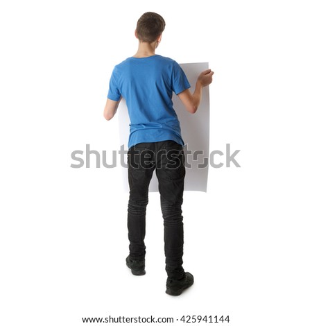 Cute teenager boy in blue T-shirt with banner in hands standing over white isolated background full body from back - stock photo
