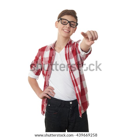 Cute teenager boy in red checkered shirt and glasses pointing forward over white isolated background, half body - stock photo