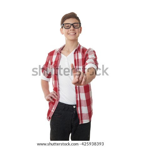 Cute teenager boy in red checkered shirt and glasses pushing something in front of himself over white isolated background, half body