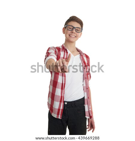 Cute teenager boy in red checkered shirt and glasses pushing something in front of himself over white isolated background, half body - stock photo