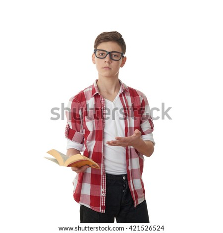 Cute teenager boy in red checkered shirt, glasses and a book over white isolated background, half body, reading concept - stock photo