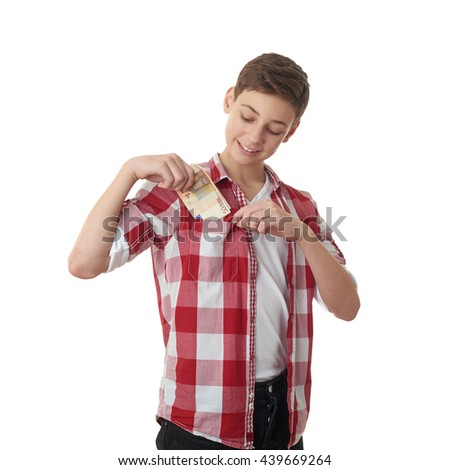 Cute teenager boy in red checkered shirt putting money into pocket over white isolated background, half body - stock photo
