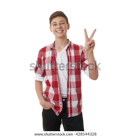Cute teenager boy in red checkered shirt showing victory sign over white isolated background, half body - stock photo