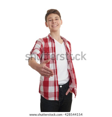 Cute teenager boy in red checkered shirt stretching hand in greeting over white isolated background, half body - stock photo