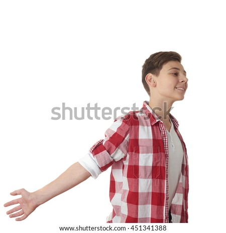 Cute teenager boy in red checkered shirt with arms raised outstretched smiling joyful over white isolated background, half body, freedom concept - stock photo