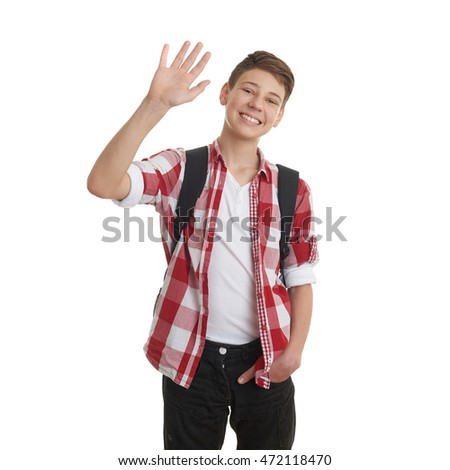 Cute teenager boy in red checkered shirt with school bag, waving hand over white isolated background, half body, as school, education concept