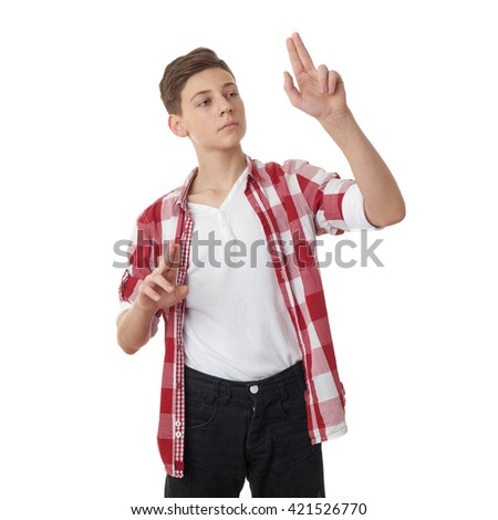 Cute teenager boy in red checkered shirt working with virtual screen over white isolated background, half body
