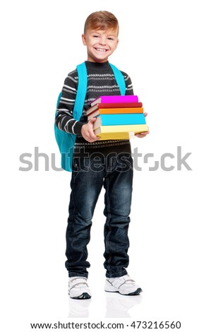 Cute teenager boy with backpack and books. Smiling schoolboy isolated on white background. Full height portrait happy child. Back to school.