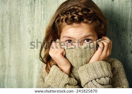 Cute teenager girl wearing warm knitted sweater. Beauty, fashion. Seasonal clothing. - stock photo
