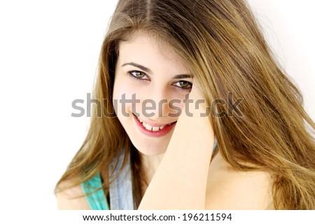 Cute teenager smiling happy in studio - stock photo