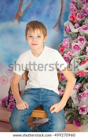 Cute teenager with christmas tree and gift