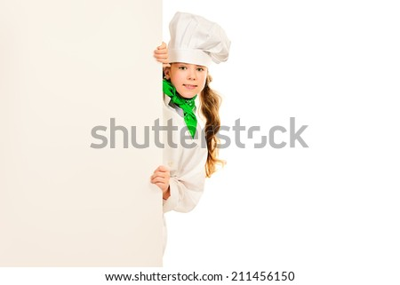 Cute ten years girl in cook clothes holds white board. Isolated over white. - stock photo